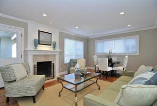Modern Living Room with Laminate floors, Glass panel door, Fireplace, can lights, Casement, Crown molding, Carpet