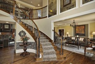 Eclectic Staircase with Hardwood floors, Cathedral ceiling