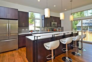 Contemporary Kitchen with Flush, European Cabinets, Simple marble counters, Casement, One-wall, Hardwood floors, Glass Tile