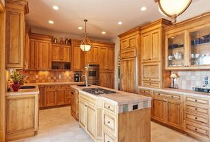 Eclectic Kitchen with Undermount sink, double wall oven, Kitchen island, Framed Partial Panel, Glass panel, Stone Tile