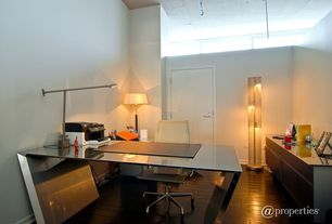 Contemporary Home Office with six panel door, Laminate floors, High ceiling