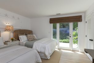 Cottage Guest Bedroom with Laminate floors, Louvered door, Carpet, Standard height, French doors