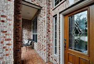 Traditional Front Door with Glass panel door, exterior stone floors
