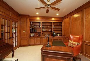 Traditional Home Office with Crown molding, French doors, Standard height, Built-in bookshelf, can lights, Ceiling fan