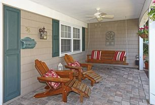 Cottage Porch with exterior stone floors, double-hung window, Porch swing, six panel door