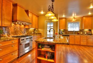 Traditional Kitchen with double-hung window, Chandelier, full backsplash, Laminate floors, French doors, single dishwasher