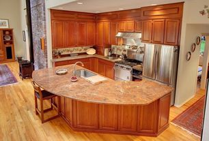 Traditional Kitchen with gas range, Complex granite counters, can lights, Flush, Undermount sink, Kitchen island, L-shaped