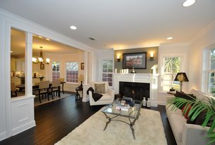 Traditional Living Room with Crown molding, Columns, Wall sconce, Hardwood floors