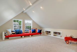Modern Playroom with Carpet, Chair rail, Wainscotting, Standard height, can lights, Casement, Built-in bookshelf