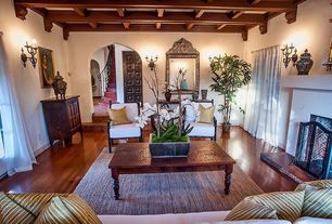 Craftsman Living Room with Wall sconce, Wood panel ceiling, Box ceiling, Sunken living room, French doors, Arched doorway