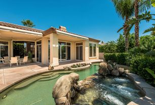 Mediterranean Swimming Pool with Pool with hot tub, Transom window, Raised beds, exterior tile floors
