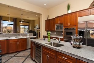 Contemporary Kitchen with Large Ceramic Tile, can lights, U-shaped, Kitchen peninsula, Wine refrigerator, Flat panel cabinets