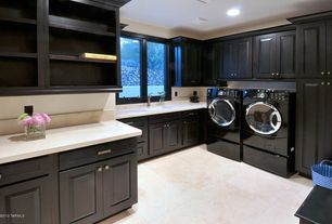 Modern Laundry Room with Farmhouse sink, Casement, laundry sink, Built-in bookshelf, Limestone counters, can lights, Paint 2