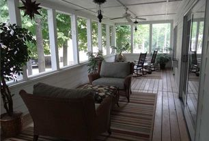 Traditional Porch with Rocking chair, Outdoor furniture, Screened porch, Wood decking, Indoor/outdoor rug, Ceiling fan