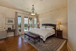 Mediterranean Guest Bedroom with flush light, Carpet, French doors, Laminate floors