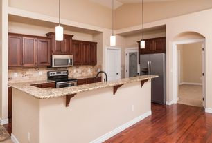 Traditional Kitchen with Stone Tile, Simple granite counters, Pendant light, Flat panel cabinets, Kitchen island, L-shaped