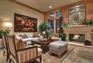 Traditional Living Room with High ceiling, Transom window, Cement fireplace, Crown molding