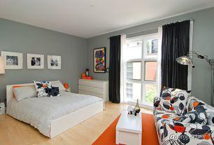 Contemporary Guest Bedroom with Hardwood floors, Glass panel door