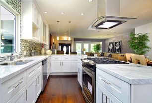 Traditional Kitchen with Breakfast bar, Complex marble counters, specialty door, Breakfast nook, Flat panel cabinets, Galley