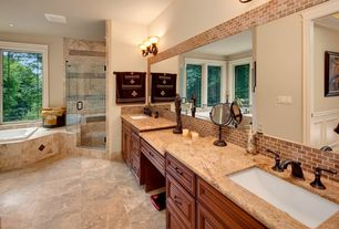 Mediterranean Master Bathroom with Simple granite counters, Casement, Bathtub, can lights, Undermount sink, Wall sconce