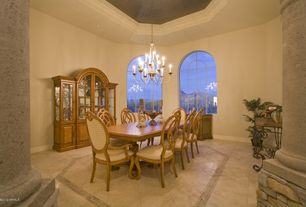 Mediterranean Dining Room with Chandelier, can lights, Cathedral ceiling, Arched window, Columns, stone tile floors