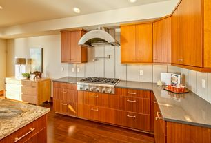Contemporary Kitchen with Complex granite counters, L-shaped, Bamboo floors, Concrete counters, European Cabinets, Flush