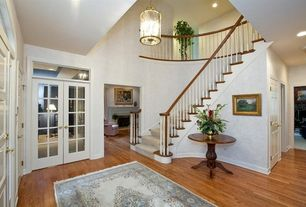 Traditional Entryway with Carpet, Hardwood floors, Transom window, French doors, Pendant light