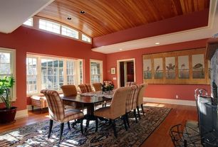 Craftsman Dining Room with Hardwood floors, Cathedral ceiling, metal fireplace, French doors