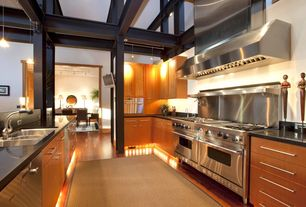 Contemporary Kitchen with Soapstone, can lights, partial backsplash, drop-in sink, One-wall, Flat panel cabinets, Wall Hood