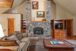 Rustic Living Room with Laminate floors, High ceiling, Exposed beam, stone fireplace
