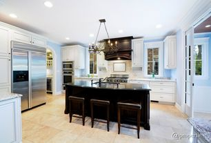 Traditional Kitchen with built-in microwave, stone tile floors, Simple Granite, partial backsplash, electric cooktop