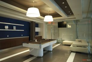 Contemporary Game Room with Box ceiling, Pendant light, Exposed beam, Corian- Designer White, Built-in bookshelf