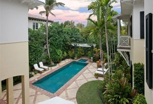 Tropical Swimming Pool with exterior stone floors, exterior brick floors, Pool with hot tub