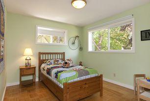 Country Guest Bedroom with Casement, no bedroom feature, Hardwood floors, flush light, Standard height