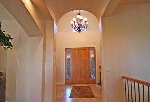 Traditional Entryway with flat door, travertine floors, Cathedral ceiling, Chandelier