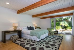 Contemporary Guest Bedroom with Carpet, Laminate floors, French doors, Exposed beam