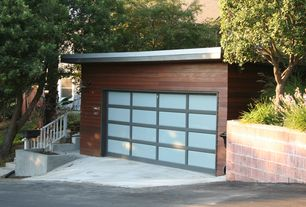 Contemporary Garage with Standard height, folding door, Concrete floors