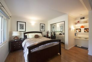 Eclectic Guest Bedroom with Built-in bookshelf, High ceiling, Hardwood floors, Crown molding, Wall sconce