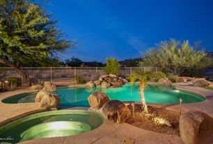 Rustic Swimming Pool with Pool with hot tub, exterior stone floors, Fence