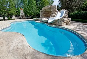 Contemporary Swimming Pool with Fence, exterior stone floors, outdoor pizza oven