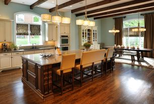 Craftsman Kitchen with Destination lighting chandelier with drum shades - three lights, Arched window, Framed Partial Panel