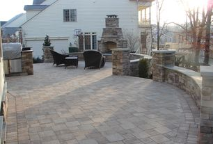 Traditional Patio with Outdoor kitchen, outdoor pizza oven, Fence, exterior stone floors