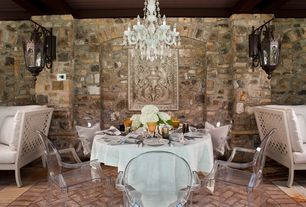 Contemporary Dining Room with Moroccan antiqued finish iron wall brackets, Louis ghost chair - crystal