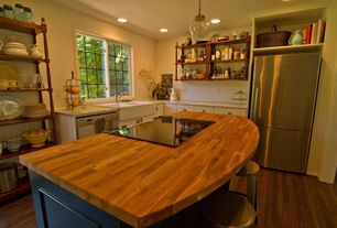 Cottage Kitchen with Simple granite counters, L-shaped, specialty window, dishwasher, Farmhouse sink, Built-in bookshelf