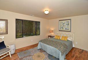 Modern Master Bedroom with picture window, Hardwood floors, Standard height, flush light