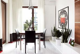 Contemporary Dining Room with High ceiling, Pendant light, French doors, Concrete floors