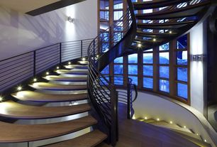 Contemporary Staircase with Hardwood floors, Step lighting, Spiral staircase, High ceiling, Wall sconce
