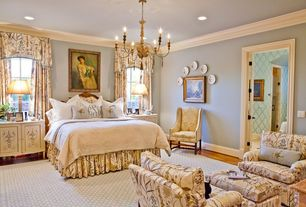 Traditional Master Bedroom with double-hung window, Carpet, can lights, Chandelier, Standard height