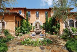 Mediterranean Patio with exterior stone floors, Fence, specialty window, Glass panel door, picture window, double-hung window