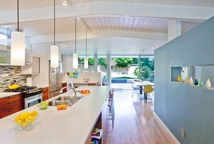 Contemporary Kitchen with Pendant light, Herman miller - eames molded fiberglass side chair in lemon yellow, Exposed beam